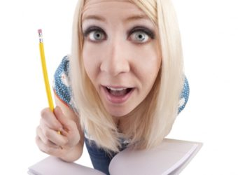 Excited Student With A Composition Book